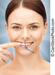 婦女, 由于, 白色的牙齒