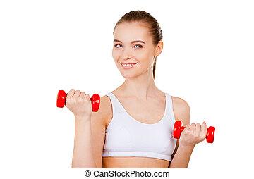 婦女, 行使, 由于, dumbbells., 有吸引力, 年輕婦女, 在, 運動衣服, 訓練, 由于, dumbbells, 以及, 微笑, 當時, 站立, 被隔离, 在懷特上