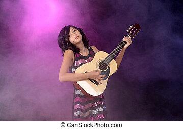 子が遊ぶ, ギター, ステージ上で