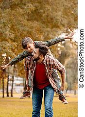 寄付, piggyback の 乗車, 父, 息子