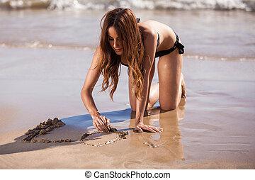 寫, 在沙子上