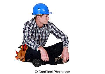 工匠, 坐在地板上