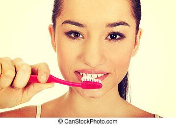 年輕婦女, 刷, 她, teeth.
