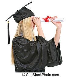 年輕婦女, 在, 畢業長袍, 調查, 距離, 透過, 畢業証書