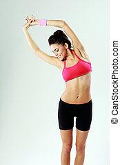 年輕, 愉快, 運動婦女, 伸展, 上, 灰色的背景