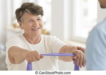 年長の 女性, テープ, 伸縮性がある