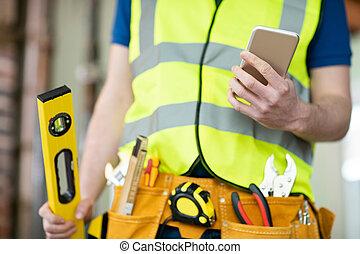 建物, 身に着けていること, モビール, 道具, 労働者, 細部, サイト, 電話, 建設, 使うこと, ベルト