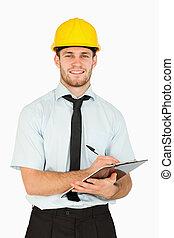 彼の, メモ, リード, 微笑, クリップボード, 取得, 労働者, 若い