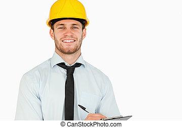 彼の, リード, 微笑, クリップボード, 労働者, 若い