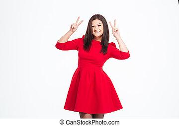 微笑の 女性, 中に, 赤いドレス, 提示, 2本の指, 印