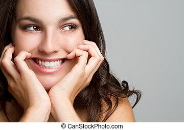 微笑, 若い女性