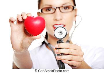 心, 彼女, 医者, 手。, 若い, 女性