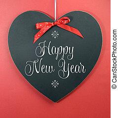 心, 書かれた, 黒板, 挨拶, に対して, バックグラウンド。, 形, 年, 新しい, メッセージ, 赤, 幸せ