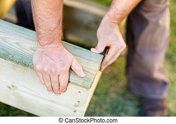 手冊, worker's, 手, 固定, 木頭, 在, 站點