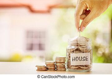 手, パッティング, コイン, 中に, ガラスジャー, そして, 家, ラベル, ∥で∥, ぼやけ, の, 家, 背景, ∥ために∥, お金, セービング, ∥ために∥, 家, ∥あるいは∥, 不動産, ローン, 概念