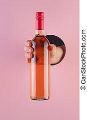 手, ペーパー, 穴, バラ, によって, びん, ピンク, 手掛かり, ワイン, バックグラウンド。