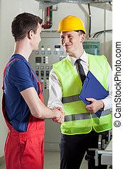握手, 工場