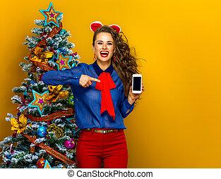 携帯電話, 女性の指すこと, スクリーン, 木, ブランク, クリスマス