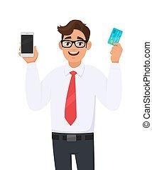 新しい, デザイン, 提示, cell), 若い, カード, (mobile, ベクトル, 借方, 保有物, デジタル, クレジット, 概念, smartphone, ビジネスマン, 銀行, cartoon., 手。, 現代, 特徴, illustration., ∥あるいは∥, マレ, ライフスタイル, atm