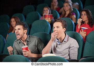 朋友, 在, cinema., 二個朋友, 觀看的電影, 在, the, 電影院, 由于, 人們, 上, the, 背景