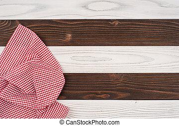 木製である, 上に, 折られる, テーブルクロス, テーブル。, 赤