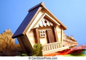 木製の家, 下に, 青い空