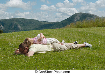 父 と 子供, 芝生に