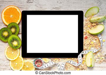 片劑, 電腦, 上, a, 木製的桌子, 由于, 水果, 以及, a, 測量磁帶, 為, 重量損失, 以及, 節食