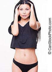 甜, seduction., 有吸引力, 年輕婦女, 在, 黑色, 內衣, 扣留手, 在, 頭髮, 以及, 看  照相機, 當時, 站立, 針對, 背景