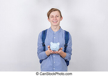 男の子, ティーネージャー, concept., 上に, 白, バックグラウンド。, 保有物, 銀行, 小豚, 教育, 節約, 財政, 微笑