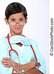 男の子, 外科医, 服を着せられる
