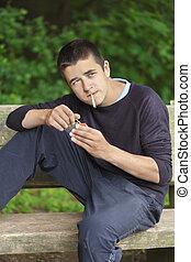 男孩, 由于, a, 香煙, 上, a, 長凳