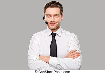 男性, operator., 漂亮, 年輕人, 在, formalwear, 以及, 耳機, 看  照相機, 以及, 微笑, 當時, 站立, 針對, 灰色, 背景