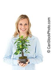 相當, 婦女藏品, a, 植物, 在, 她, 手