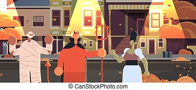 穿, 愉快, 背景, 魔鬼, 街道, 肖像, 人們, 外部, 建筑物, 詭計, 都市風景, 城市, 媽咪, 服裝, 蛇神, 夜晚, 步行, 万圣節, 概念, 鎮, 對待, 水平, 黨, 慶祝