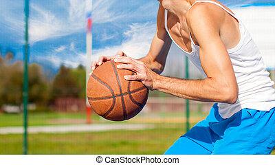 籃球選手, 由于, a, 球, 在, 他的, 手