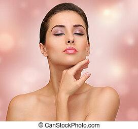 美しい女性, 感動させる表面, きれいにしなさい, 皮膚, 上に, ピンクの背景