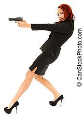 美しい女性, 黒いスーツ, かかと, 狙いを定める, ピストル