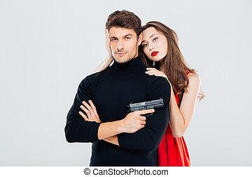 美しい, 恋人, 若い, 抱き合う, 銃, ポーズを取る