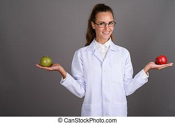 美しい, 灰色, 女性の医者, 若い, に対して, 背景
