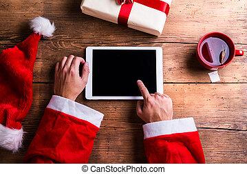 聖誕老人, 由于, 片劑