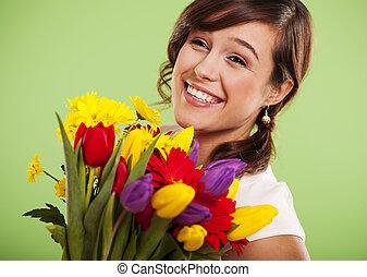 肖像, 在中, a, 微笑妇女, 带, 色彩丰富的花