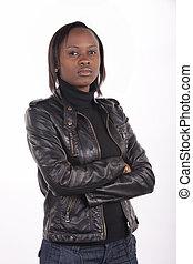 若い, 南アフリカ人, 女, 身に着けている黒, 革, そして, a, 真剣な表現, 上に, a, 白,...