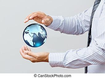 藏品, a, 發光, 地球全球, 在, 他的, 手