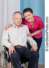 護士, 站立, 所作, the, 無能力, 在, a, 輪椅