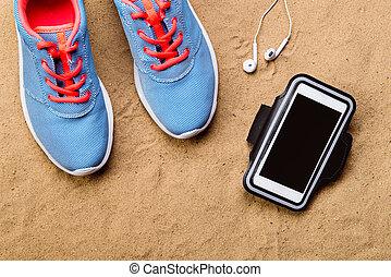 運動鞋, 耳機, smartphone, 針對, 沙子, 工作室, 射擊。