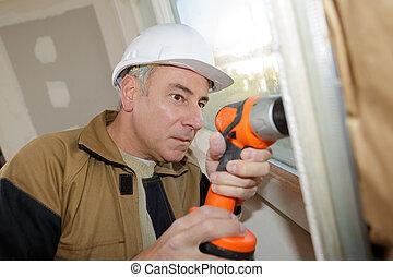 電気である, 壁, 労働者, perforator, 建設, ボーリングする