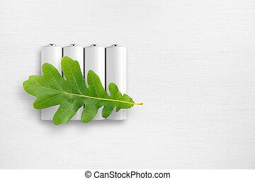 電池, そして, 緑, オーク葉, 白, テーブル。, 生態学的, エネルギー, concept.