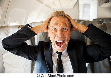 頭, 彼の, モデル, 感動的である, 衝撃を与えられた, flight., 見る, 間, カメラ, 成長した, 手, ビジネスマン, 恐れ, 席, 飛行機