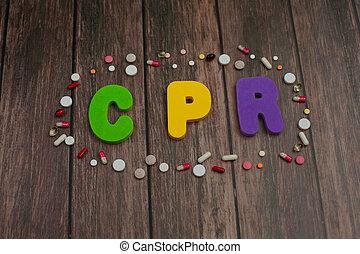 顏色, 字母表, 在, 詞, cpr, 縮寫, ......的, cardiopulmonary 复活, 大約, 藥丸, 上, 木頭, 背景。